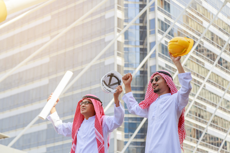 Successful Young arab architect and engineer celebrating win