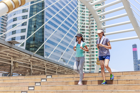 pursuing: two female joggers pursuing their activity outdoors in the city Stock Photo