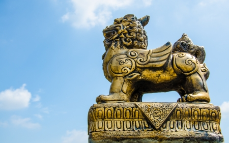 Gold lion statue against blue sky in Thailand Stock Photo - 16597256