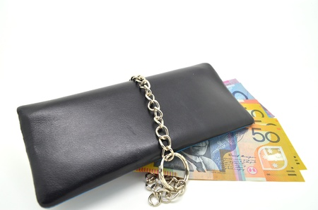 black leather wallet with lock and some banknote Stock Photo