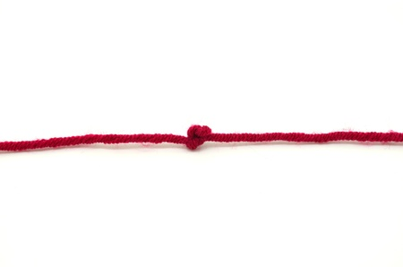 Red rope with knot, isolated on white background