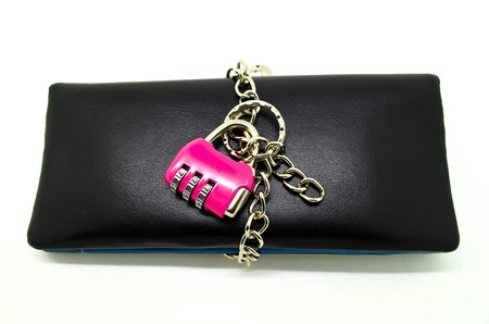 Wallet kept lock with key chain, concept for money savings. photo