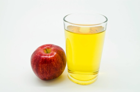 red apple and a glass of apple juice