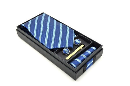 blue striped necktie in a box on a white background