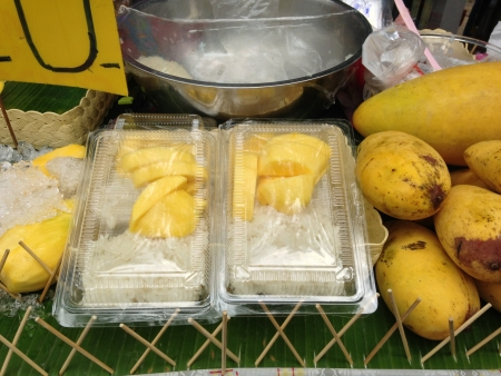 popular Thai dessert, mango with sticky rice can be found easily in the market