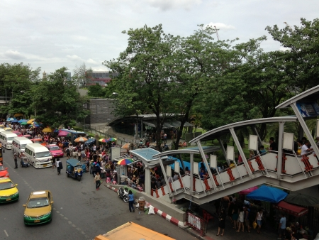 Bangkok � July 2013 a lot of people and traffic in front of the weekend market in Bangkok, Thailand