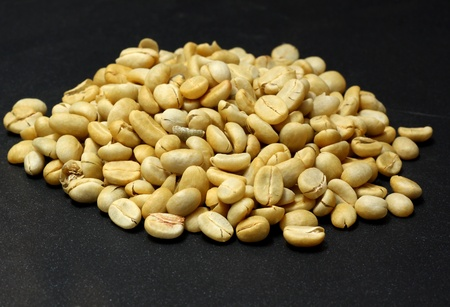 Fresh coffee beans not roast  on background color black photo