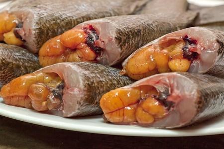 pectoralis: fresh fish   trichogaster pectoralis   on white dish