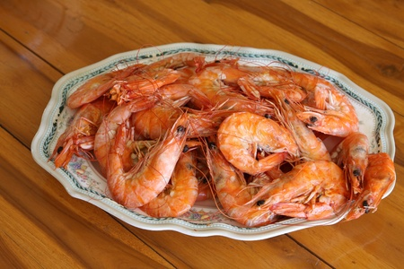 Steamed shrimp in dish on the table photo