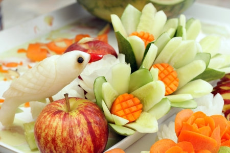 Carved fruits and vegetables in the basket Stock Photo
