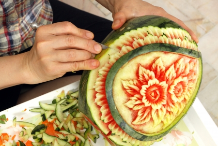 elaboration: Woman s hands carved watermelon show step Stock Photo