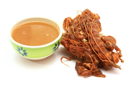 Tamarind and tamarind juice  on white background 스톡 콘텐츠