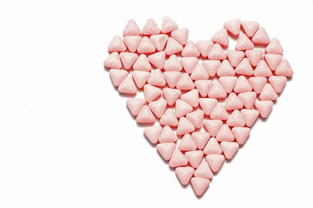 Medical concept created by pills in form of a heart on white background Stock Photo - 13916541