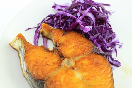 Fish fry with red cabbage in the evening photo