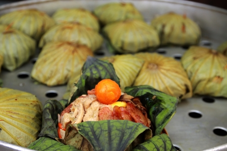 Cooked rice wrapped with lotus leaf photo