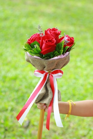 beautiful bouquet of bright red flowers, on hand photo