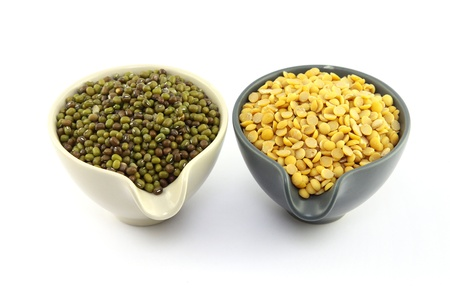Soybeans, split in half and Mung beans in cup photo