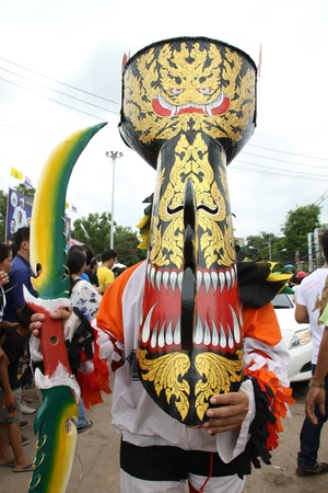 LOEI PROVINCE,THAILAND-JULY 23:Unidentified men wear ghost costumes at Ghost Festival (Phi Ta Khon - a masked procession celebrated by Buddhist) at Dan Sai district in Loei Province on July 23, 2012.
