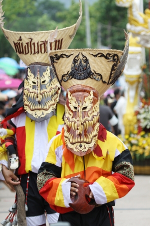 LOEI PROVINCE,THAILAND-JUNE 23:Unidentified men wear ghost costumes at Ghost Festival (Phi Ta Khon - a masked procession celebrated by Buddhist) at Dan Sai district in Loei Province on July 23, 2012.