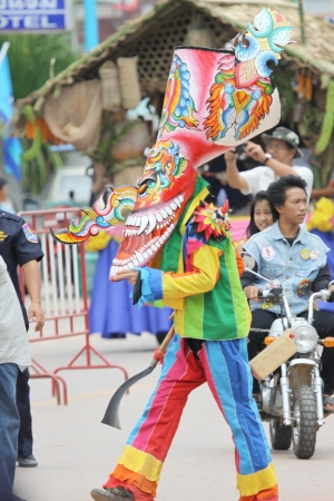 LOEI PROVINCE,THAILAND-JUNE 23:Unidentified men wear ghost costumes at Ghost Festival (Phi Ta Khon - a masked procession celebrated by Buddhist) at Dan Sai district in Loei Province on JuNE 23, 2012.