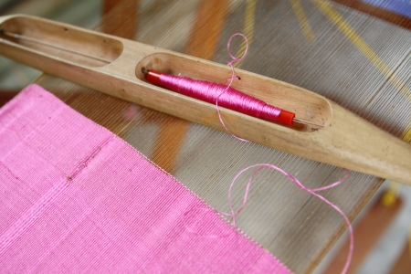 Part of loom white thread homemade in Thailand photo