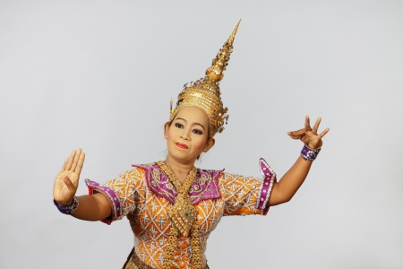 BANGKOK, THAILAND - JANUARY 15: Thai Traditional Dress. This is the ancient acting of Khon-Thai classical masked ballet in Thailand, January 15, 2012 in Bangkok, Thailand. Stock Photo - 14904882