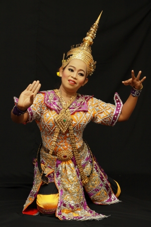 BANGKOK, THAILAND - JANUARY 15: Thai Traditional Dress. This is the ancient acting of Khon-Thai classical masked ballet in Thailand, January 15, 2012 in Bangkok, Thailand. Stock Photo - 14904888