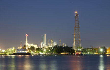 Oil refinery at twilight with river Bangkok Thailand  photo