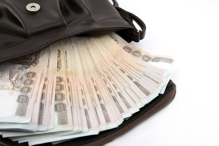 bag of money: Thai money on lady leather bag color brown for shopping in holiday Stock Photo