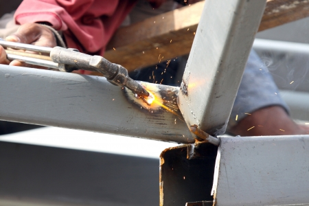 acetylene: Sparks during cutting of metal by gas welding in site Stock Photo