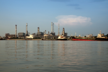 refinement: panorama on liquid and natural petroleum gas refinery plant area with big ship , Bangkok, Thailand.