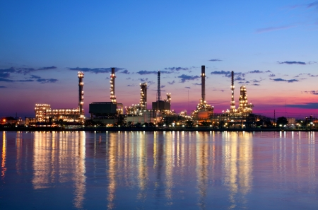 petrochemical oil refinery factory pipeline in the morning near river at  Bangkok Thailand 스톡 콘텐츠