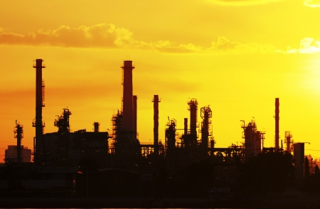 petrochemical oil refinery factory pipeline silhouette in the morning near river at  Bangkok Thailand
