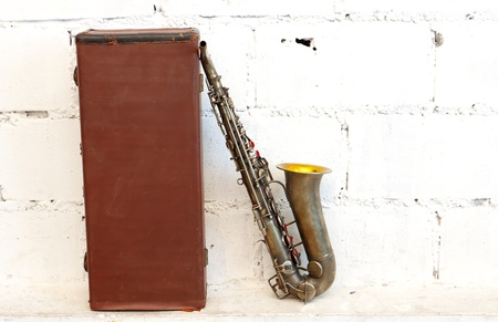 The old saxophone with bag photo