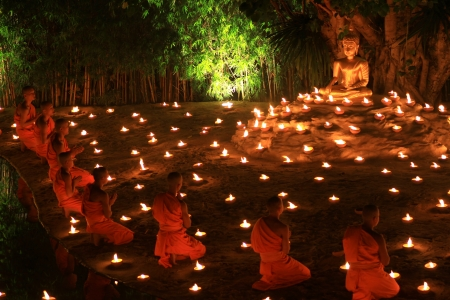 CHIANG MAI, THAILAND - November 28: Loy Kratong Festival, Buddhist monk fire candles to the Buddha on Nov 28, 2012 in Phan Tao Temple, Chiangmai, Thailand.