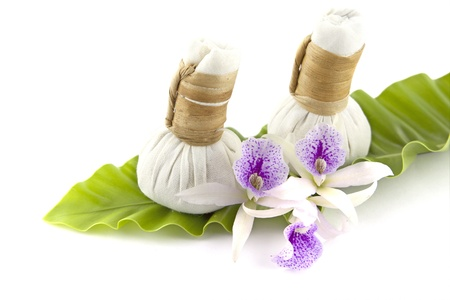 herbal compress with orchid flower on white background