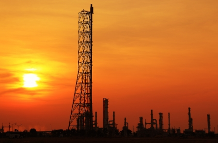 Landscape oil refinery at sunset