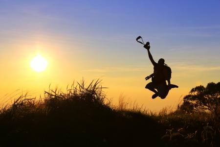 Photographer jump on highest mountain view photo