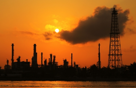Oil refinery silhouette at sunrisee