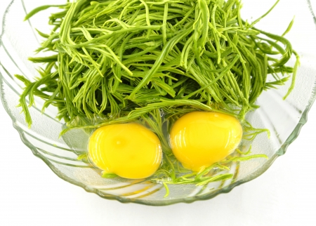cha-om vegetable with eggs on dish for cooking Stock Photo
