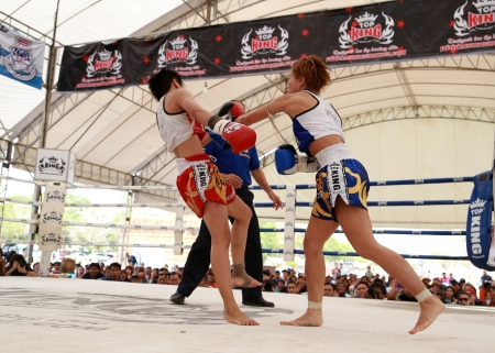 AYUTTHAYA, THAILAND- MARCH 17 : Women Thai boxing match at World Muay Thai Fight Fastival on March 17, 2013 in Ayutthaya, Thailand.