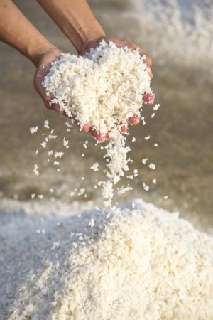salt mine: white salt heart shapes on hands