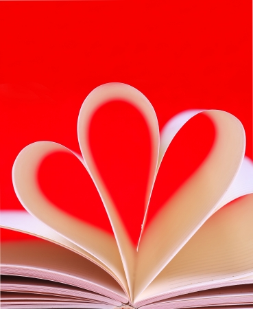 paper hearts book, valentines day , day valentine on red background photo