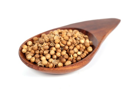 Heap coriander seeds in wooden spoon Stock Photo - 19788280