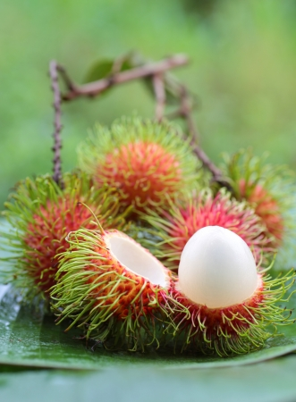 asian fruit rambutan on banana leaves photo