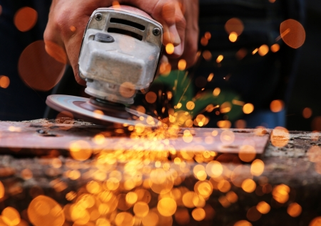 Electric wheel grinding on steel structure