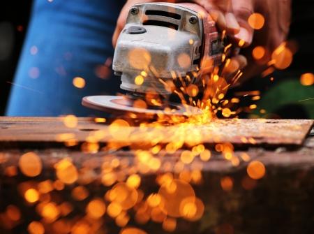 Metal grinding on steel sheet close up Zdjęcie Seryjne
