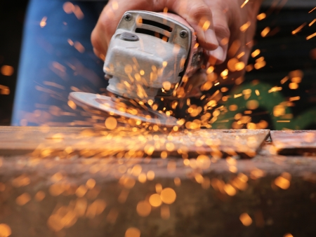 hand tool: Metal grinding on steel sheet close up Stock Photo