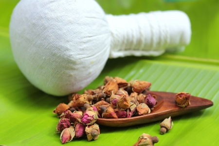 herbal massage ball: Flower tea rose buds on banana leaves with herbal massage ball