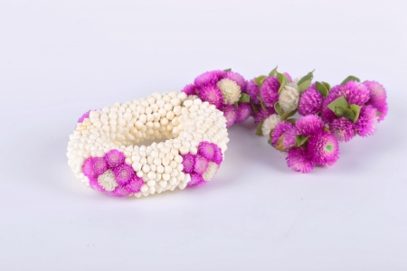 Flower garlands in thai style on white background, used offering to buddha  photo